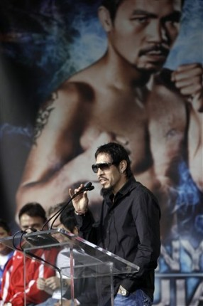 Robert Garcia, right, trainer for Antonio Margarito, explains a recently released video as Manny Pacquiao, center, and his trainer Freedie Roach, left, listen during a news conference Wednesday, Nov. 10, 2010, in Arlington, Texas. Pacquiao and Margarito are scheduled to fight Saturday night at Cowboys Stadium for the WBC World Super Welterweight title. AP Photo/David J. Phillip