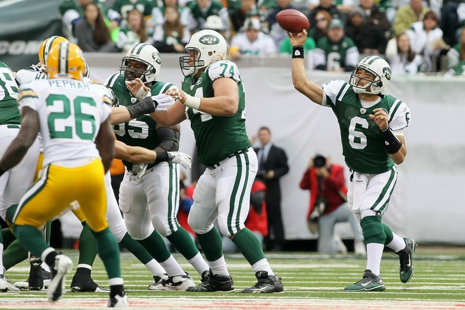 East Rutherford , NJ,. Mark Sanchez (6) of the New York Jets throws a pass against the Green Bay Packers on October 31, 2010 at the New Meadowlands Stadium in East Rutherford, New Jersey. The Packers defeated the Jets 9-0 . Photo by Jim McIsaac/Getty Images .....
