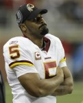 File file photo shows Washington Redskins quarterback Donovan McNabb on from the sidelines after being benched during the fourth quarter of an NFL football game against the Detroit Lions, in Detroit. With the game on the line against the Lions, Mike Shanahan decided McNabb wasn't competent enough to stay on the field. The coach made a stunner of a move, yanking his offensive captain from the game and inserting Rex Grossman, a decision that has ramifications for the rest of the season and into 2011. AP Photo/Paul Sancya, File