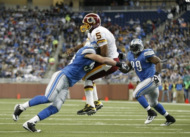 Kyle Vanden Bosch #93 of the Detroit Lions hits Donovan McNabb #5 of the Washington Redskins during the first quarter of the game at Ford Field on October 31, 2010 in Detroit, Michigan. Photo by Leon Halip/Getty Images