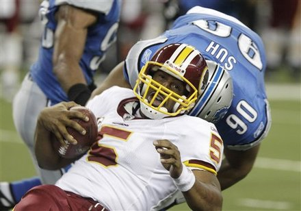 Washington Redskins quarterback Donovan McNabb (5) is sacked by Detroit Lions defensive tackle Ndamukong Suh (90) during the first quarter of an NFL football game at Ford Field in Detroit, Sunday, Oct. 31, 2010. AP Photo/Carlos Osorio ......