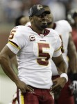 Washington Redskins quarterback Donovan McNabb (5) looks on from the sidelines after being benched during the fourth quarter of their NFL football game against the Detroit Lions in Detroit, Sunday, Oct. 31, 2010. Detroit won 37-25. AP Photo/Paul Sancya