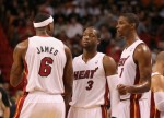 LeBron James (6), Dwyane Wade (3), and Chris Bosh (1) of the Miami Heat talk during a game against the Washington Wizards at American Airlines Arena on November 29, 2010 in Miami, Florida. Photo by Mike Ehrmann/Getty Images .........