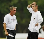 Mike Shanahan coach of the Washington Redskins and his son Kyle the team's offensive coordinator seen here at the team's training facility in Ashburn, Virginia ,. courtesy of Associated Press/ Mitch Hutchenson .............