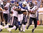Mike Hart (32) of Indianapolis Colts runs with the ball while tackled by Zac Diles (54) and Bernard Pollard (31) of the Houston Texans during the NFL game at Lucas Oil Stadium on November 1, 2010 in Indianapolis, Indiana. Photo by Andy Lyons/Getty Images ......