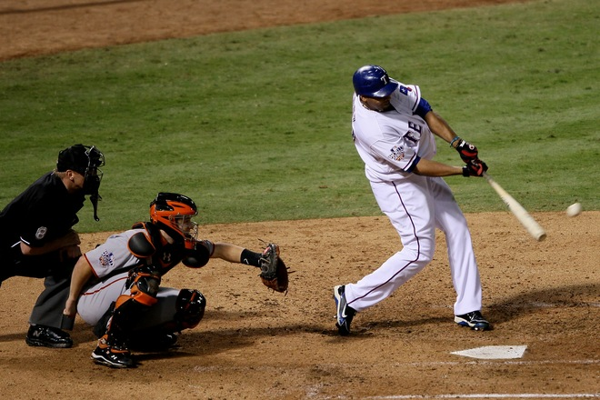 Nelson Cruz (17) of the Texas Rangers hits a solo home in the seventh inning against Tim Lincecum (55) of the San Francisco Giants in Game Five of the 2010 MLB World Series at Rangers Ballpark in Arlington on November 1, 2010 in Arlington, Texas. Photo by Elsa/Getty Images