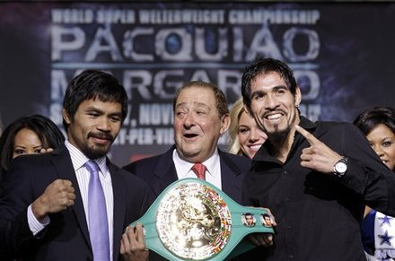 Manny Pacquiao, left, and Antonio Margarito, right, pose with boxing promoter Bob Arum, center, during a news conference Wednesday, Nov. 10, 2010, in Arlington, Texas. The boxers are scheduled to fight Saturday night at Cowboys Stadium for the WBC World Super Welterweight title. AP Photo/David J. Phillip