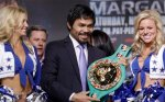 Manny Pacquiao, flanked by Dallas Cowboys cheerleaders, smiles as he holds the title belt during a news conference Wednesday, Nov. 10, 2010, in Arlington, Texas. Pacquiao is scheduled to fight Antonio Margarito Saturday night at Cowboys Stadium for the WBC World Super Welterweight title. AP Photo/David J. Phillip