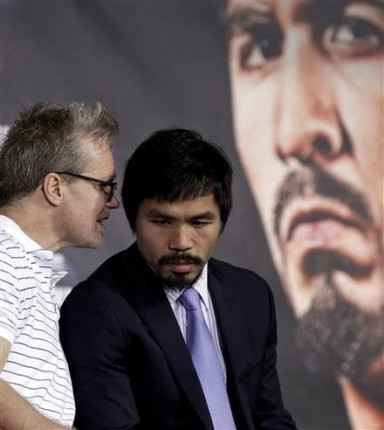 Manny Pacquiao, right, listens to his trainer Freddie Roach, left, during a news conference Wednesday, Nov. 10, 2010, in Arlington, Texas. Pacquiao is scheduled to fight Antonio Margarito Saturday night at Cowboys Stadium for the WBC World Super Welterweight title. AP Photo/David J. Phillip .........