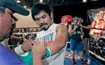 Boxer Manny Pacquiao of the Philippines, is gloved-up during a workout in Grapevine, Texas, Tuesday, Nov. 9, 2010. Pacquiao is scheduled to fight Antonio Margarito, of Mexico, on Saturday in Arlington, Texas, for the vacant WBC light middleweight title. AP Photo/LM Otero .........