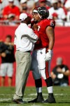 TAMPA, FL - NOVEMBER 14: Head coach Raheem Morris of the Tampa Bay Buccaneers has some words for offensive lineman Donald Penn #70 during the game against the Carolina Panthers at Raymond James Stadium on November 14, 2010 in Tampa, Florida. Photo by J. Meric/Getty Images ....