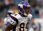 Minnesota Vikings wide receiver Randy Moss (84) walks across the field before an NFL football game against the New England Patriots in Foxborough, Mass. The Vikings released Moss on Monday, Nov. 1 and that has sparked a debate in Chicago on whether or not the Chicago Bears should go after the troubled receiver. The player having been released by the Vikings was claimed off waivers by the Tennessee Titans who this week have a bye . AP Photo/Stephan Savoia .....