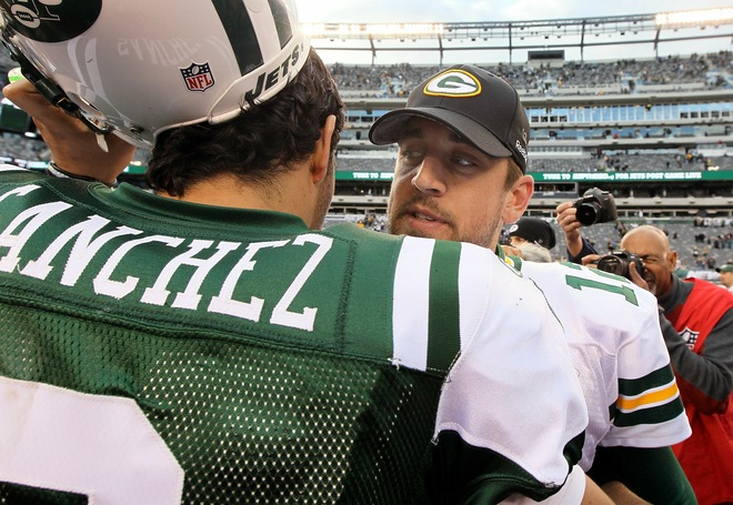 Mark Sanchez (6) of the New York Jets congratulates Aaron Rodgers (12) of the Green Bay Packers after their game on October 31, 2010 at the New Meadowlands Stadium in East Rutherford, New Jersey. The Packers defeated the Jets 9-0. Photo by Jim McIsaac/Getty Images ....