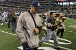 Injured quarterback Tony Romo of the Dallas Cowboys walks off the field with his head down after the Cowboys lost 35-17 against the Jacksonville Jaguars at Cowboys Stadium on October 31, 2010 in Arlington, Texas. Photo by Stephen Dunn/Getty Images .....