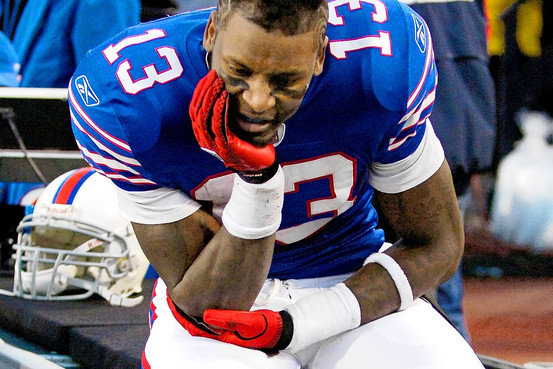 Steve Johnson of the Buffalo Bills sits on the sidelines contemplating a dropped pass in the endzone during last Sunday's NFL game against the Pittsburgh Steelers played Bills Stadiums in Orchard Park , New York . The Steelers would go on to defeat the Bills 19-16 . Associated Press ...........