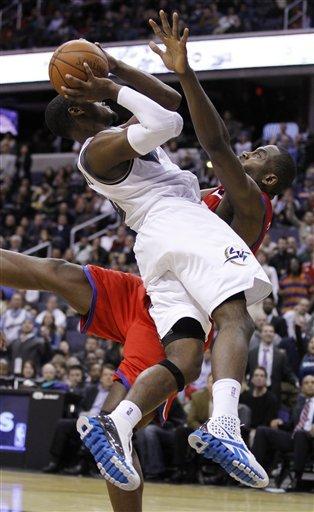Washington Wizards' John Wall, left, is fouled by Philadelphia 76ers' Elton Brand, right, during overtime of an NBA basketball game Tuesday, Nov. 2, 2010, in Washington. The Wizards won 116-115. AP Photo/Luis M. Alvarez ......