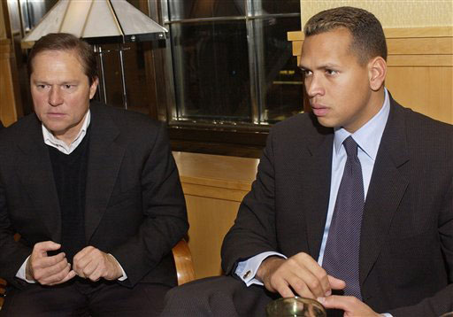 Uber-agent Scott Boras, seated left and perhaps his most high profiled major league client, Alex Rodriguez. Over the course of his career Boras negotiated contracts said to be worth in excess of $ 4.8 billion. And he was at the center of the most recent acquisitions made by the New York Yankees ,in that of Mark Teixiera and A. J. Burnett, two more of his clients. Of the ten highest paid players in the game , six of those are clients of Scott Boras. picture appears courtesy of ap/photo/Hugh MacIntosh ………