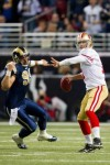 ST. LOUIS, MO - DECEMBER 26 : Alex Smith (11) of the San Francisco 49ers passes the ball against C.J. Ah You (99) of the St. Louis Rams at the Edward Jones Dome on December 26, 2010 in St. Louis, Missouri. The Rams beat the 49ers 25-17. Photo by Dilip Vishwanat/Getty Images .........