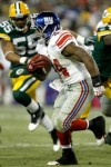 Ahmad Bradshaw (44) of the New York Giants carries the ball against the Green Bay Packers at Lambeau Field on December 26, 2010 in Green Bay, Wisconsin. Photo by Matthew Stockman/Getty Images .........