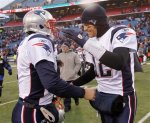 New England Patriots quarterback Tom Brady (12) and backup quarterback Brian Hoyer (8) smile after the Patriots' 34-3 win over the Buffalo Bills in an NFL football game in Orchard Park, N.Y., Sunday, Dec. 26, 2010. AP Photo/Mike Groll .........