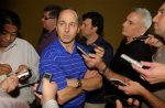 New York Yankees general manager Brian Cashman, center, talks to reporters during a media availability session at the baseball general managers meeting in Lake Buena Vista, Fla., Tuesday, Nov. 16, 2010. AP Photo/Phelan M. Ebenhack ........