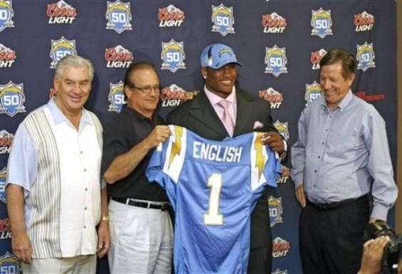 San Diego Chargers' first-round draft pick Larry English, second from right, holds up his new jersey as, from left to right, general manager A.J. Smith, team President & CEO Dean Spanos and head coach Norv Turner look on during a news conference Sunday, April 26, 2009, in San Diego. English, a linebacker, is from Northern Illinois. AP Photo/Jack Smith ..........