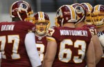 Quarterback Rex Grossman (8) of the Washington Redskins huddles the offense against the Dallas Cowboys in the first quarter at Cowboys Stadium on December 19, 2010 in Arlington, Texas. Photo by Ronald Martinez/Getty Images .............