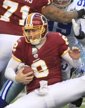 Redskins' Rex Grossman having been sacked by the Cowboys' Gerald Sensenbaugh is unable to get himself in motion as he falls to the the ground during the game played at Cowboys' Stadium , Arlington, Texas . The Cowboys would go on to defeat the Redskins 33-30 . AP Photo / Sharon Mulcahy ..........
