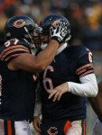 Jay Cutler (6) of the Chicago Bears gets a hug from teammate Olin Kreutz (57) after running for a touchdown against the New York Jets at Soldier Field on December 26, 2010 in Chicago, Illinois. The Bears defeated the Jets 38-34 . Photo by Jonathan Daniel/Getty Images ...........