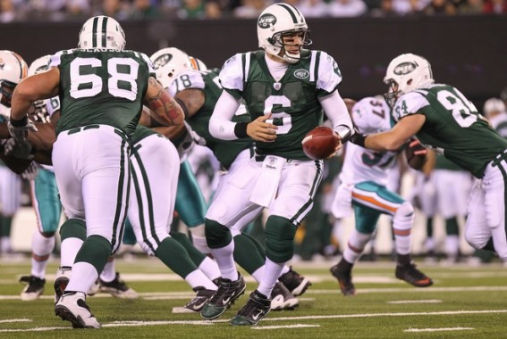 Mark Sanchez (6) of the New York Jets looks to hand the ball off against the Miami Dolphins at New Meadowlands Stadium on December 12, 2010 in East Rutherford, New Jersey. Photo by Nick Laham/Getty Images ........
