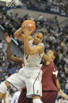 Maya Moore comes down with a rebound in the first half in front of Florida State's Chelsea Davis. The UConn women won 93-62 Tuesday at the XL Center for their record 89th consecutive win. Hartford Courant/ Michael McAndrews ................