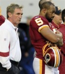 Washington Redskins head coach Mike Shanahan, left, and quarterback Donovan McNabb stand on the sidelines before an NFL football game against the Dallas Cowboys, Sunday, Dec. 19, 2010, in Arlington, Texas. AP Photo/Tim Sharp ..........