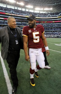 Arlington, Tx,. Quarterback Donovan McNabb #5 of the Washington Redskins walks off the field after a loss against the Dallas Cowboys at Cowboys Stadium on December 19, 2010 in Arlington, Texas. Photo by Ronald Martinez/Getty Images ........
