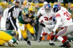 Brandon Jackson #32 of the Green Bay Packers carries the ball against the New York Giants at Lambeau Field on December 26, 2010 in Green Bay, Wisconsin. Photo by Matthew Stockman/Getty Images ...........