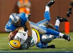 Green Bay Packers quarterback Aaron Rodgers (12) gets tackled by Detroit Lions linebacker Landon Johnson (55) and is knocked out of the game in the second quarter of the NFL football game in Detroit, Sunday, Dec. 12, 2010. AP Photo/Rick Osentoski .....