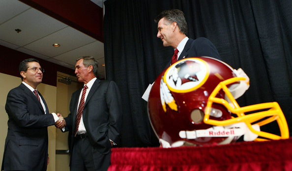 Mike Shanahan (C) shakes hands with Washington Redskins owner Daniel Snyder (L) as General Manager Bruce Allen (R) looks on before Shanahan was announced as the new head coach of the Washington Redskins on January 6, 2010 in Ashburn, Virginia. Shanahan replaces former head coach Jim Zorn who was released January 4 following a 4-12 season. Win MacNamee/ Getty Images ................