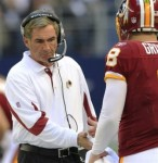 Washington Redskins head coach Mike Shanahan greets quarterback Rex Grossman on the sideline against the Dallas Cowboys during the second half of an NFL football game, Sunday, Dec. 19, 2010 in Arlington, Texas. AP Photo/Tim Sharp ..........