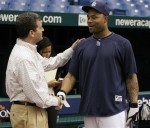 Tampa Bay Rays owner Stuart Sternberg, left, talks to left fielder Carl Crawford during baseball practice Tuesday, Oct. 5, 2010, in St. Petersburg, Fla. The Rays host the Texas Rangers in Game 1 of the American League Division Series on Wednesday. AP Photo/Chris O'Meara .........