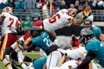 Washington Redskins running back Ryan Torain (46) dives into the end zone over the top of Jacksonville Jaguars cornerback Don Carey (22) during the second half of an NFL football game in Jacksonville, Fla., Sunday, Dec. 26, 2010. The Redskins won in overtime 20-17. AP Photo/Reinhold Matay ........