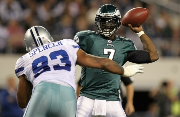Quarterback Michael Vick (7) of the Philadelphia Eagles drops back to pass against Anthony Spencer (93) of the Dallas Cowboys at Cowboys Stadium on December 12, 2010 in Arlington, Texas. Photo by Ronald Martinez/Getty Images ......