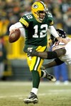 Quarterback Aaron Rodgers (12) of the Green Bay Packers attempts to break free from Tommie Harris (91) of the Chicago Bears at Lambeau Field on January 2, 2011 in Green Bay, Wisconsin. Photo by Matthew Stockman/Getty Images .......