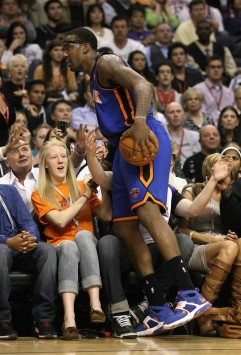 Amar'e Stoudemire (1) of the New York Knicks nearly falls into the crowd after attempting to save an out of bounds ball against the Phoenix Suns during the NBA game at US Airways Center on January 7, 2011 in Phoenix, Arizona. The Knicks defeated the Suns 121-96. Photo by Christian Petersen/Getty Images ......