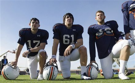 Auburn kicker Wes Byrum, right, deep snapper Josh Harris (61), and punter Ryan Shoemaker watch defensive drills during NCAA college football practice Wednesday, Jan. 5, 2011, in Scottsdale, Ariz. Bynum has five game-winning field goals on his resume, including two this season, for a decided edge in clutch kicking experience over his Oregon counterpart. Auburn is scheduled to play Oregon in the BCS championship on Monday in Glendale, Ariz. AP Photo/Ross D. Franklin ........