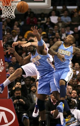 Blake Griffin (32) of the Los Angeles Clippers goes for a loose ball against Nene > (31) and J.R. Smith (5) of the Denver Nuggets at Staples Center on January 5, 2011 in Los Angeles, California. The Clippers won 106-93 . Photo by Stephen Dunn/Getty Images ...........