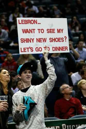 A fan holds up a sign during the game between the Milwaukee Bucks against the Miami Heat at the Bradley Center on January 7, 2011 in Milwaukee, Wisconsin. The Heat defeated the Bucks 101-95 in overtime. Photo by Scott Boehm/Getty Images ......