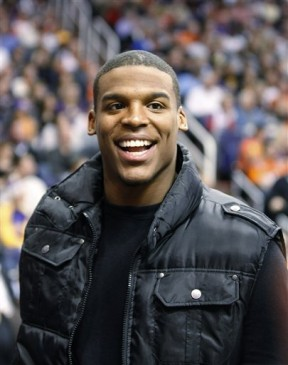 Auburn quarterback Cam Newton smiles as fans call out his name while he takes in the Los Angeles Lakers-Phoenix Suns NBA basketball game in Phoenix on Wednesday, Jan. 5, 2011. Auburn and Oregon are scheduled to play in the BCS championship college football game Monday in Glendale, Ariz. AP Photo/Ralph Freso .........