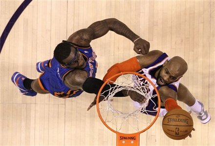 Phoenix Suns' Vince Carter , right, scores as New York Knicks' Amare Stoudemire defends during the first quarter of an NBA basketball game Friday, Jan. 7, 2011, in Phoenix. The Knicks defeated the Suns 121-96 . AP Photo/Ross D. Franklin ..............