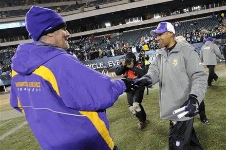 Minnesota Vikings interim coach Leslie Frazier , right, and injured quarterback Brett Favre shake hands after an NFL football game against the Philadelphia Eagles, Tuesday, Dec. 28, 2010, in Philadelphia. Minnesota won 24-14 . AP Photo/Miles Kennedy ..........