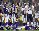 Chicago Bears' Brian Urlacher (54) looks down as Minnesota Vikings quarterback Brett Favre (4) lies on the ground after being hit during the first half an NFL football game in Minneapolis. Vikings interim coach Leslie Frazier said Thursday, Dec. 30, that Favre hasn't passed a post-concussion test, leaving the 41-year-old quarterback roughly three more days to gain medical clearance to play Sunday at Detroit. AP Photo/Andy King ......