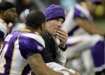 In this Dec. 13, 2010 photo, Minnesota Vikings quarterback Brett Favre watches from the sidelines against the New York Giants in the first half of their NFL football game at Ford Field in Detroit. AP Photo/Paul Sancya, File .........